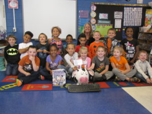 Mrs. Pittman's class with their pumpkin- Click, Clack, Moo