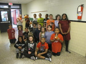 Mrs. Anderson's class with their pumpkin- The True Story of the Three Little Pigs
