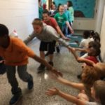 5th graders getting high fives during their walk